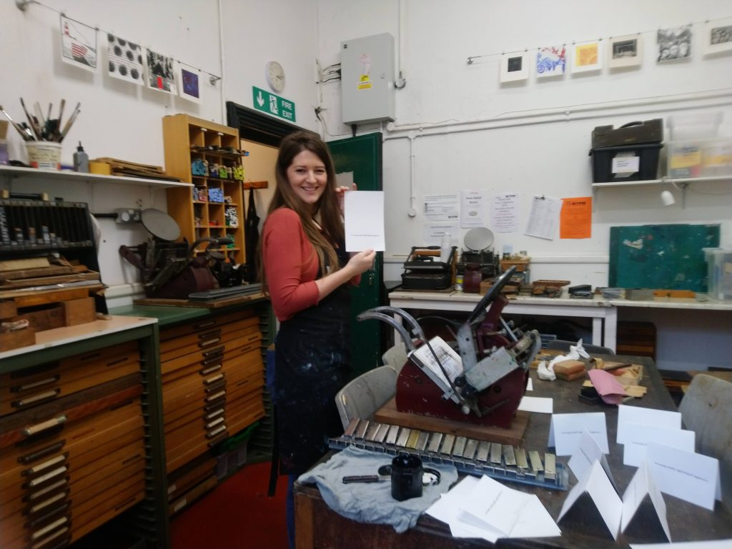 Alicia on a work placement with us, testing out letterpress equipment.