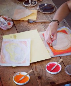 Mokuhanga process - Painting with watercolour to add printable colour to a carved woodblock.