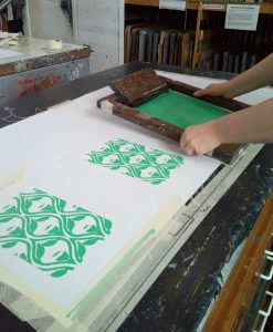 Course attendee learning how to Screenprint onto textiles