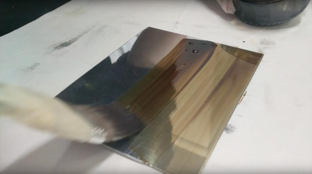 Apply wax ground to etching plate