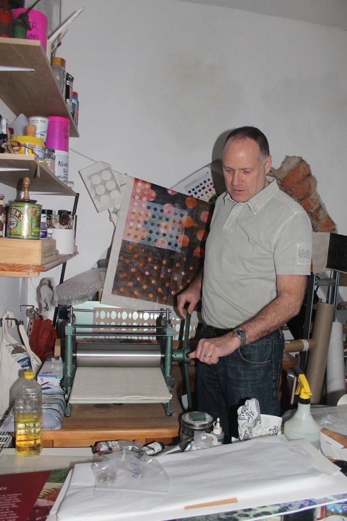Neil in studio, using etching press