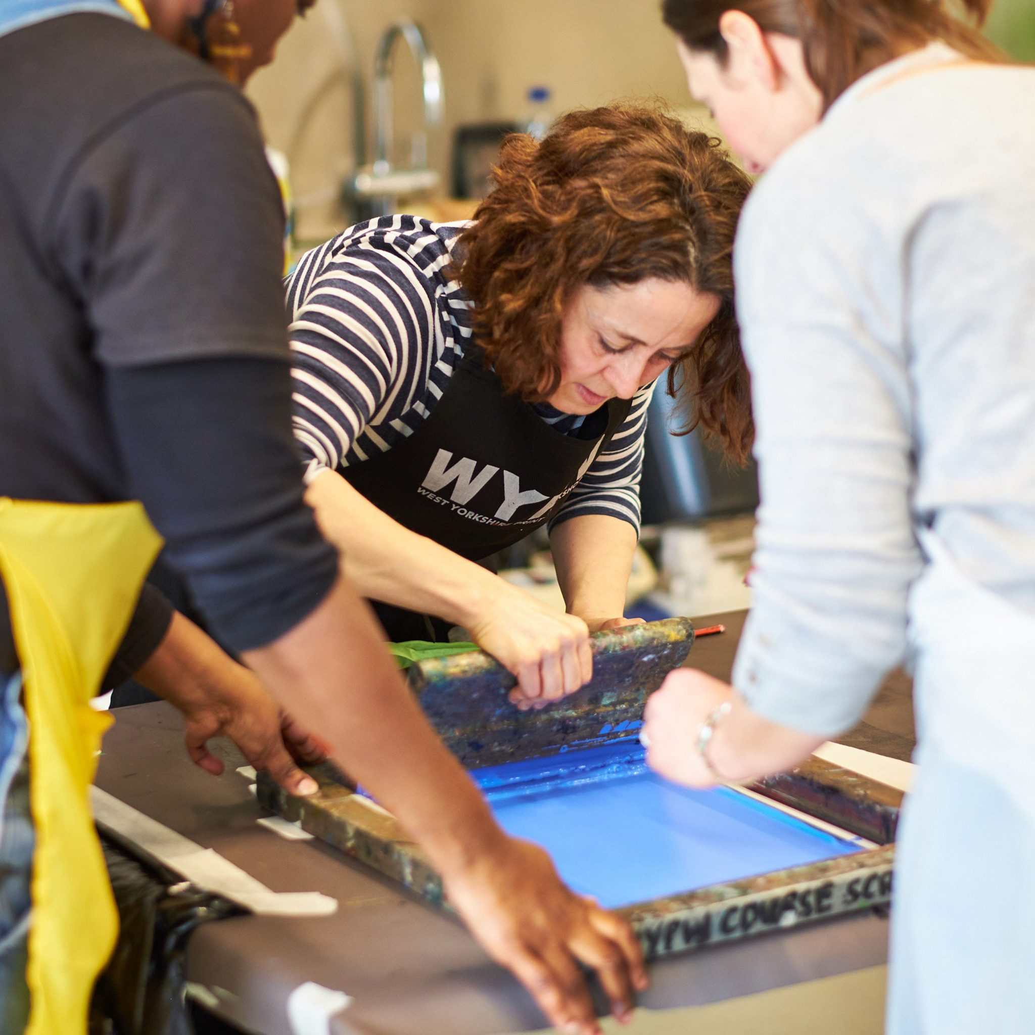 Karen Stansfield teaching screen printing