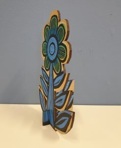 Side view of blue flower by Samantha Groom