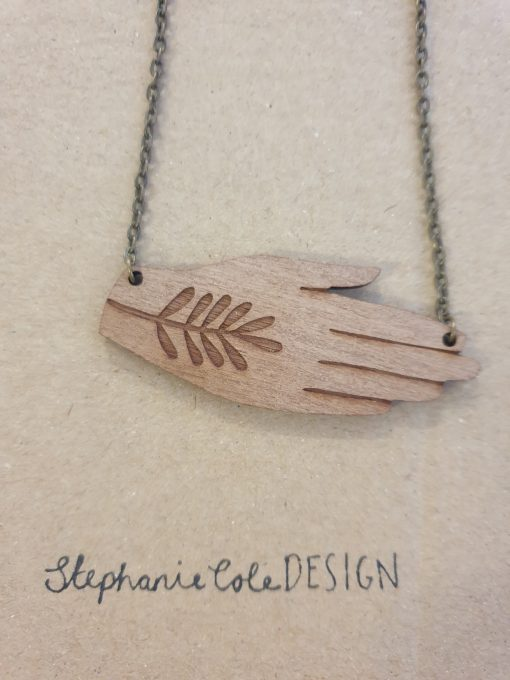 Wooden hand necklace by Stephanie Cole
